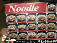 Dishes with noodles in food court